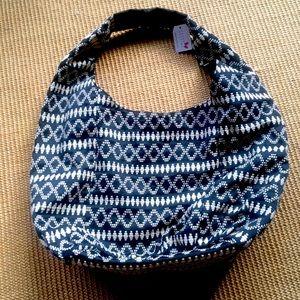 Hobo black & white shoulder bag with snap close